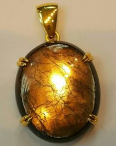 gold sheen sapphire pendant with strong gold aurora effect