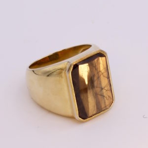 gold sheen sapphire mens ring with copper and bronze tones